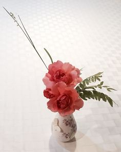 Ikebana--rose, grass and tree leaves collected at back yard.