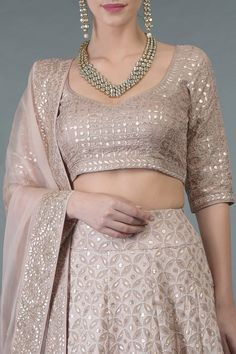 From our Bridal Heritage Collection, this timeless Dusky Pink outfit presenting a beautiful fusion of heritage thread crafts Chikankari, rose gold gota patti, beads and sequin hand embroidery. The lehenga is crafted in pure georgette and adorned Indian Fashion Dresses, Dress Indian Style, Indian Designer Outfits, Designer Dresses, Fashion Outfits, Lehenga Skirt, Lehnga Dress, Lehenga Blouse, Pink Lehenga