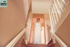 Bride coming down the stairs. Irish Marquee wedding photographed by Couple Photography.