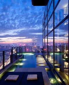 Steve Leung Designed Penthouse with balcony swimming pool! Yes I believe I would stay here.
