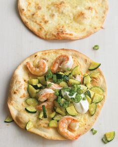 Brush flour tortillas with olive oil, sprinkle with Monterey Jack cheese, and bake until golden to create the foundation for these mild tostadas.  Saute shrimp and zucchini with garlic and lime juice, and scatter over the tortillas with scallions and sour cream.