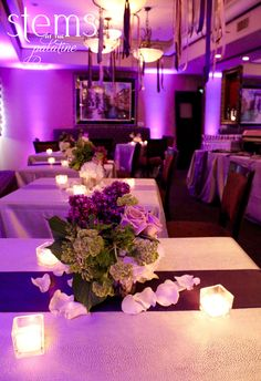 Reception centerpieces by Stems at The Palatine. To see more check out our blog! http://www.rsvp-blog.com/lifes-celebrations-1/glamorous-purple-theme-surprise-party
