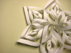 One of my favorite things to do every year with my daughter is make paper snowflakes to hang in the house and place on our windows. This is a fancier version that I will try this year!