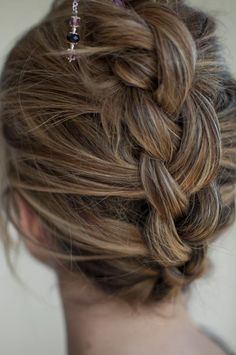 upside-down & backwards braided hairstyle with hairsticks