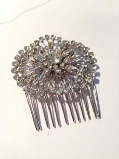 How to Create a Hair Comb From a Vintage Brooch. This would be great for my hair at the wedding. Something old, something borrowed....from my mother. Love it.