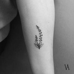 Fine line style lavender tattoo on the left forearm. Tattoo Artist: Violeta Arús