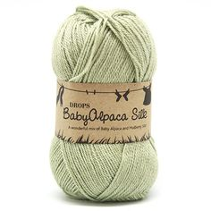 Drops BabyAlpaca Silk Uni Colour -       Naalddikte: 3.5     Gewicht: 50 gr.     Lengte: 167 m     Proeflapje 10x10cm: 23 steken x 30 naalden     Samenstelling: 70% Alpaca, 30% Zijde