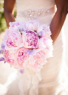 Lush blooms of ruffled pink peonies make for an incredibly romantic bridal bouquet.