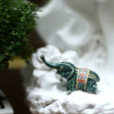 Green elephant with basketwork.