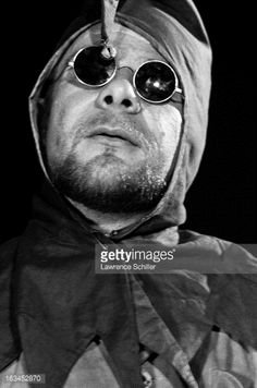 Close-up of an unidentified Merry Pranksters, in a costume and sunglasses, while on an LSD (Lysergic acid diethylamide, better known as acid) 'trip,' Los Angeles, California, 1966. The Merry Pranksters, focused around author Ken Kesey, were a group who traveled around the United States promoted various forms of psychedelic drugs.