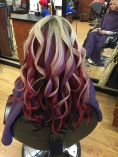 Blonde top, red middle, dark brown bottom.. with pops of purple. I have never received so many compliments before. Love love love my hair .