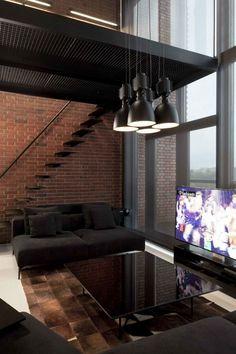 Designer-Loftwohnung einrichtung backsteinwand schwarze möbel fensterfront