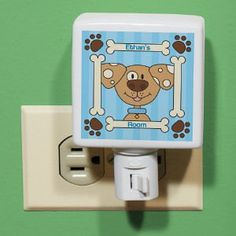 Personalized Little Boy Night Light - Personalized Puppy NightlightCreate a warm and comforting glow each night you put your baby to sleep with this whimsical Child Night Light. This Personalized Night Light features a fun design of an adorable puppy surrounded by puppy bones a theme your little guy is sure to love. Personalized Little Boy Nightlights make great baby gifts and a lovely addition to any baby?s room.