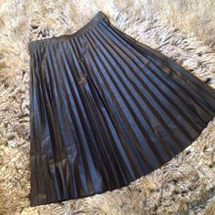 """Pleated faux leather skirt Black pleated faux leather skirt, elastic in the waistband. M and XL available. M=L:23.5"""", W:12.75"""",  XL=L:24.5"""", W:15.5"""". Does have some stretch.  Brand new without tags. Please ask me to make you a separate listing for purchase. DO NOT PURCHASE THIS LISTING. Charlotte Russe Skirts Circle & Skater"""