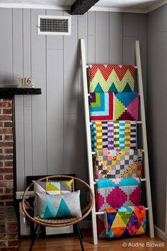 Quilt ladder with modern quilts at Blue is Bleu