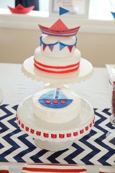 Love the little sailboat cake.