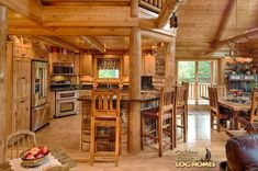 Log Home By Golden Eagle Log Homes - golden eagle log logs cabin home homes house houses rustic knotty pine custom design designs designer floor plan plans kit kits building luxury built builder complete package packages kitchen snack bar counter elevated hickory posts exposed beams dining room antique stone granite decorating ideas