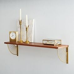 Mid-Century Shelving + Brackets #westelm - in an antique brass starburst pattern, come with pecan-finished wood shelf