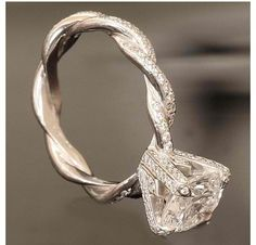 Vintage wedding ring.. the pretzel twirl isn't something I'd like, but i love the rock.