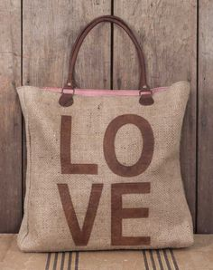 """A Great Size and a Great Bag! 17""""L x 17""""H x 4""""D This bag is made from tightly woven burlap and leather. It features leather drop handles and a ticking lining with an inside back pocket. Ships in 5-7 business days."""