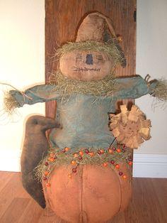 Primitive Scarecrow and Pumpkin