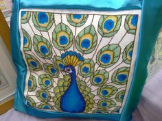 cross stitched peacock cushion  hand made tulipacious design