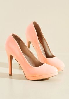 Give your sneaks a rest and add some verve to your day's ensemble with these platform stilettos! These peach pumps are crafted from glossy, faux leather uppers and kick your daily activities - from errands to a lunch date - up a notch!