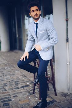 Pair a light blue tartan sportcoat with navy chinos to create a smart casual look. Finish off this look with black leather brogues.   Shop this look on Lookastic: https://lookastic.com/men/looks/blazer-dress-shirt-chinos/14496   — White Dress Shirt  — Navy Knit Tie  — White Pocket Square  — Light Blue Plaid Blazer  — Navy Chinos  — Black Leather Brogues