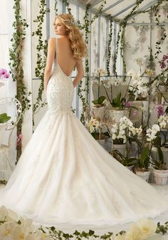 An amazing mix of lace, romance with a modern touch, this is one of the wedding dresses that will make you feel like a start that you are! the Mermaid Wedding Gown features intricate Crystal Beaded Embroidery on Tulle. Colors available:White/Silver, Ivory/Silver and Light Gold/Silver.