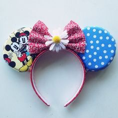 Vintage mickey and minnie inspired mouse ears with daisy and red bow. Headband fits both children and adults comfortably.