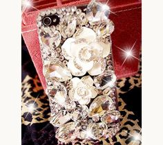 iPhone case iPhone 4 cover Bling iphone 4s case White flower iphone case crystal iphone 4s case Unique iphone case Flower iphone 4 case. $23.98, via Etsy.