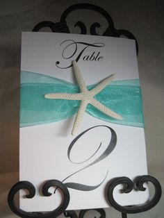 Elegant Beach Wedding Table Numbers with Starfish. $75.00, via Etsy.