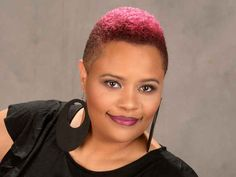 This short mohawk haircut for black women features tapered sides and burgandy hair color. It was created by T-Rod from Diverse Cuts by T-Rod in Duncanville, TX