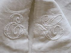 Gorgeous Antique French Linen Sheet With Centre Seam & Hand Embroidered EC Monogram. $60.00, via Etsy.