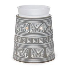 Make it modern. Reminiscent of the pyramids of the Aztec Empire, Hidalgo brings an urban edge to your home. Featuring an infinite pattern whitewashed on a smoky gray finish, topped with a frosted glass dish.