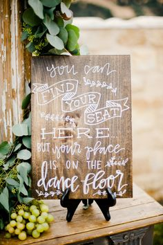 Wooden wedding sign with white writing: http://www.stylemepretty.com/2015/01/29/something-blue-fall-winery-wedding/   Photography: Megan Welker - http://www.meganwelker.com/