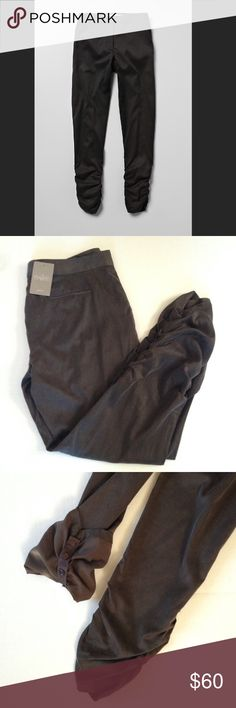 NWT Anthropologie Ruched Ankle Pants NWT Ruched ankle pants from Anthropologie brand Daughters of the Revolution. Size: 8. Color: Taupe. Adjustable gathers at the ankles of this soft pair let you show a little leg on warmer days. On colder days, undo interior buttons for a straight leg look. Side pockets. Dry clean. Anthropologie Pants Ankle & Cropped