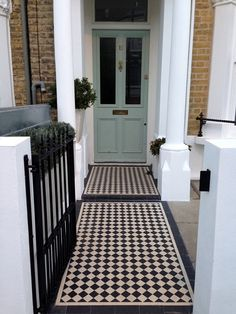 black-and-white-victorian-mosaic-tile-path-rendered-plastered-white-walls-with-wrought-iron-metal-rails-and-gate-peckham-new-cross-london-gardenista
