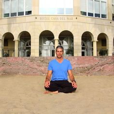 Mindfulness expert John Sahakian meditates in front of Hotel Casa del Mar.  Experience his deep relaxation & stress reduction program exclusively at Casa & Shutters on the Beach - Santa Monica, California.