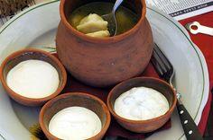 Pelmeni meat dumplings with three dipping sauces.