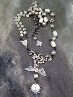 This was for sale at GetFresh Vintage Shop in Lanesboro, MN. Mother of pearl, vintage elements and bits of pieces were used to create this OOAK (One of a Kind) design for Mimi-Toria's feminine line of jewelry. Now SOLD.