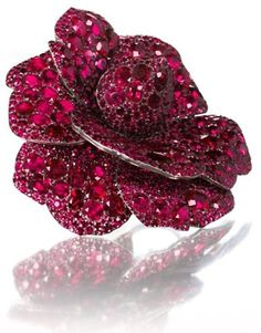 Ruby Camellia brooch by JAR (2003) from the collection of Mrs. Lily Safra to be auctioned on May 14, 2012 at Christie's Geneva