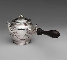 Teapot,  French 1699-1700; appears to be the only Parisian silver teapot of the period to have survived.  The custom of tea drinking was still relatively new in France at the time.