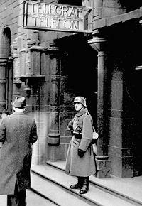 1940 April: German soldier guarding Telegrafens hovedkontor (Telegraph main office) at Prinsens gate, Oslo