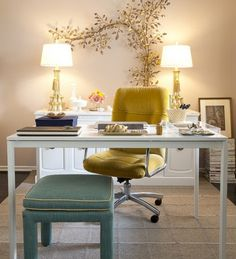white writing desk with dresser behind