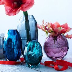 For a vignette that glistens like gemstones, check out West Elm's Faceted Glass Vases, offered in a variety of hand-cut jewel-toned selections. Add flowers in red and fuchsia tones to heighten the effect of the purple and teal palette.