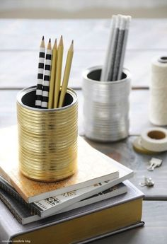 Cute idea to dress up the desk with DIY metallic tin cans as pen holders