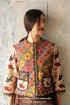 batik amarillis's parisian walkways jacket www.batikamarilli... ..add polish to your tailored wardrobe! such fitted and chic jacket with quirky twist! accented with panelled detailing & contrast trims plus 3 quirky pockets! in such lovely batik Banyumas of Indonesia