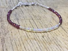A personal favourite from my Etsy shop https://www.etsy.com/no-en/listing/569133518/opal-and-red-garnet-bracelet-welo-opal