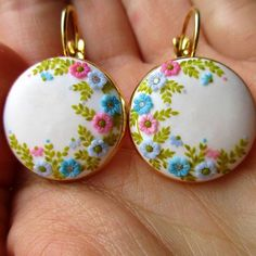 I think these earrings deserve more attention.  The flowers are so gently handmade with translucent clay. The size of diameter is 20 mm and it is full of tiny details. You can find them in my Etsy shop. The link is in my instagram profile...  .  #etsy #etsyfinds #boho #storiesmadebyhands #accessories #gift #pastelcolors #earrings #madebyme #perfection #symmetry #circle #fimo #clay #charm #magic #bohostyle #bohochic #weddingaccessories #wildflowers #bridalshower #magical #bridaljewelry ...